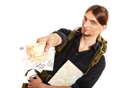 Man tourist backpacker paying euro money. Travel. - stock photo