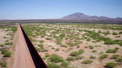 High Angle Drone of US Border Wal in Arizona Stock Footage