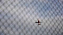 Airplane Flying over a Barbed Wire - Defocus at the end of the shot Stock Footage
