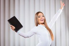 Female office worker hold case show victory sign. Stock Photos