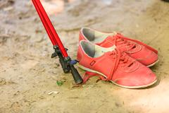Shoes and walking sticks. - stock photo