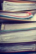 Piles of binders with documents. - stock photo