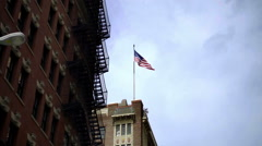 American flag waving on bright sunny day in summer in NYC Stock Footage