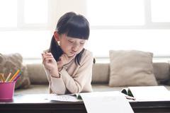 Little girl doing homework - stock photo