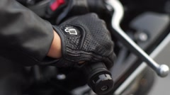 girl hand pressing motorcycle grip - stock footage