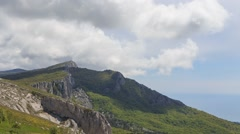 Clouds over the cliff. The ridge of Ai-Petri. Crimea - stock footage