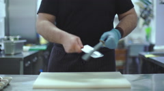Chef sharpens kitchen knife - stock footage