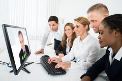 Group Of Multiracial Businesspeople Videoconferencing On Computer In Office Kuvituskuvat