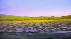 Car driving along autumn field at sunset, pov - stock footage