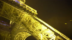 POV of person standing at Eiffel Tower bottom, viewing well-known sight in Paris Stock Footage