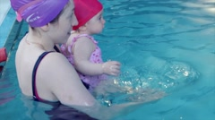 Mother with her lovely child in swimming-pool Arkistovideo