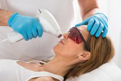 Mature Woman Receive Laser Epilation In Beauty Clinic - stock photo
