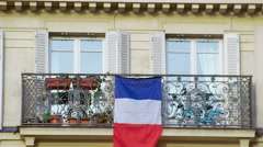 Beautiful balcony with French flag, closeup. Patriotism, love for motherland - stock footage