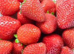 background from freshly harvested strawberries, directly above strawberries - stock photo