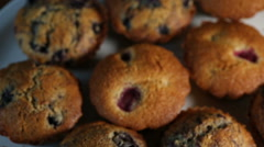 Homemade wholegrain muffins with berries on a white plate - stock footage
