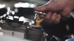 Auto mechanic repair engine in a car repair shop. Close up Stock Footage