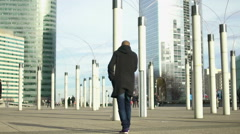 Modern lampposts standing near skyscraper business center, creativity, art Stock Footage