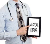 Doctor holding tablet - Medical error - stock photo