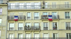 French flags hanging on balconies beautiful building, architecture, patriotism Stock Footage