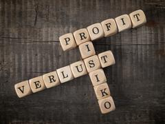 German crosswords with the words profit, risk and loss - stock photo