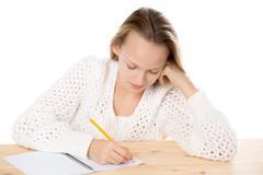 Girl writing in copybook Stock Photos