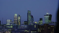 4K Successful businessman with cell phone looks out over the London city skyline - stock footage