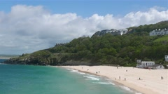Tourists enjoy Porthminster beach at St. Ives, Cornwall - stock footage
