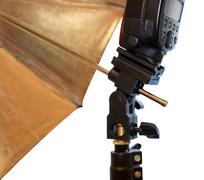 Light stand with flash and umbrella holder close up - stock photo