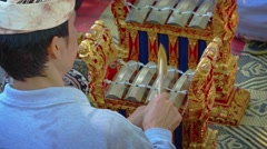 Local musician playing traditional Balinese musical instruments in ensemble Stock Footage