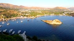 Sailboats parked at Gümüşlük bay and Rabbit Island near Bodrum, Turkey Stock Footage