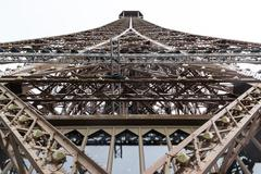 A close view of the top part of the Eiffel Tower with eighty-two meters high Stock Photos