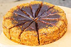 Napoleon cake covered with chocolate and walnuts - stock photo