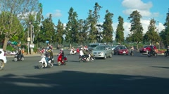 Complicated traffic at a decorative roundabout in Dalat, Vietnam Stock Footage
