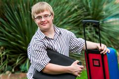 Down syndrome student with file and trolley. Stock Photos