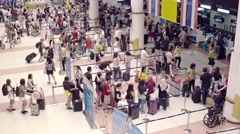 Travelers queued up at Phuket International Airport's ticketing counters Stock Footage