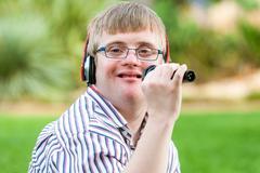 Singing handicapped boy. Stock Photos