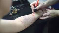 Working on Tattoo Design Stock Footage