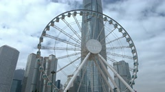 One International Finance Centre towers over Hong Kong Observation Wheel Stock Footage
