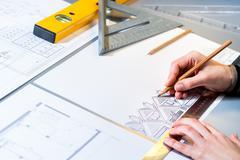 Architect planning home layout. Kuvituskuvat