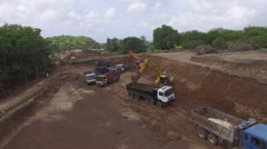 Lorries and diggers on construction site Stock Footage