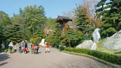 Tourists and visitors enjoying ornate gardens of Chi Lin Nunnery in Hong Kong Stock Footage