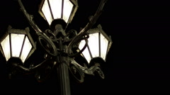 The night street of the city. Street light with three lamps in a classical style - stock footage