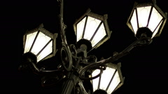The night streets of the city. Street light with four lamps in a classical style - stock footage