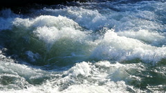 Slow motion Bubbling water in a mountain river Stock Footage