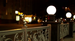The night streets of the city. The street lights placed on a forged fence. - stock footage