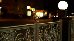 The night streets of the city. The street lights placed on a forged fence. Stock Footage