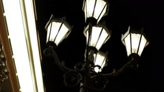 The night streets of the city. Street light with five lamps in a classical style - stock footage