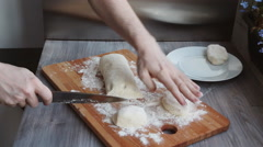 Young chef preparing bakery on a wooden board Stock Footage