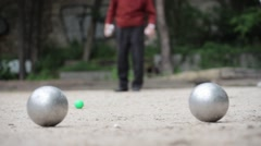 Senior Man Plays Boules In The Park Stock Footage