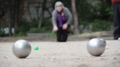 Senior Woman Plays Petanque Stock Footage